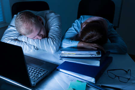 tired worker: Overworked people sleeping on desk at the work