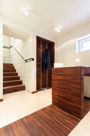 house coats: Modern interior with wooden elements and white walls