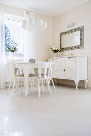 White table with chairs in classic interior photo