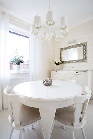 Round table in classic living room, vertical photo
