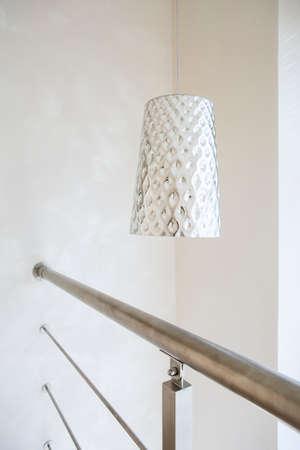 entresol: View of silver lamp in modern loft