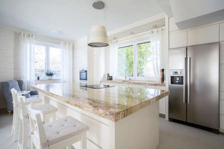 granite kitchen: View of kitchen island in bright house