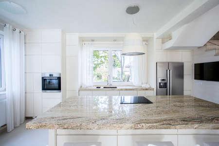 Horizontal view of bright and modern kitchen photo