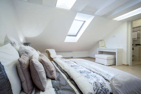 enormous: Comfy enormous bed in bright bedroom, horizontal