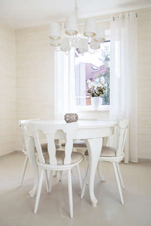 Vertical view of classic table with chairs photo