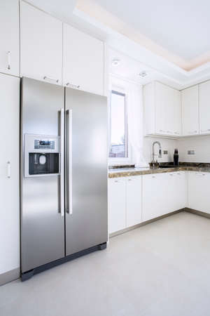 refrigerator kitchen: Spacious bright beauty kitchen with big fridge