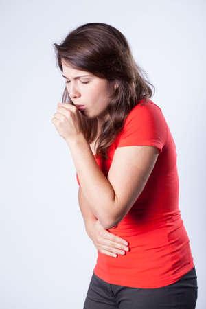Young beautiful woman and choking cough