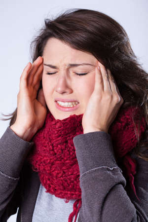 sinusitis: Young beautiful woman suffering for sinusitis Stock Photo