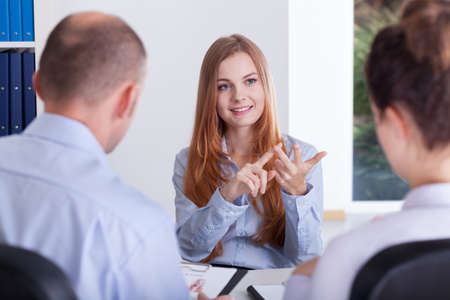query: Young clever woman during her job conversation Stock Photo