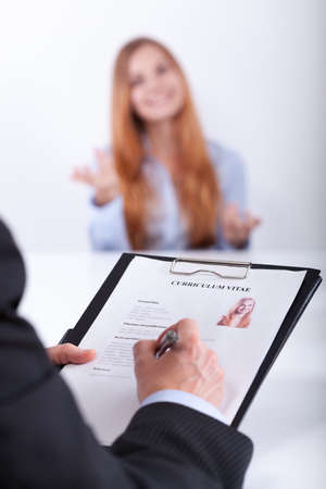 Close-up of young confident womans job application photo