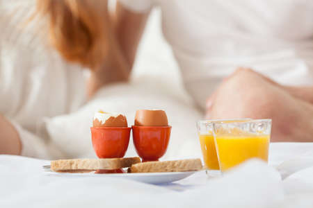 bed linen: Breakfast in bed on a lazy sunday morning