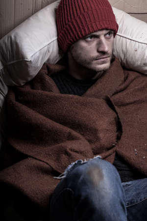 joblessness: Homeless and frozen man covers himself with a blanket
