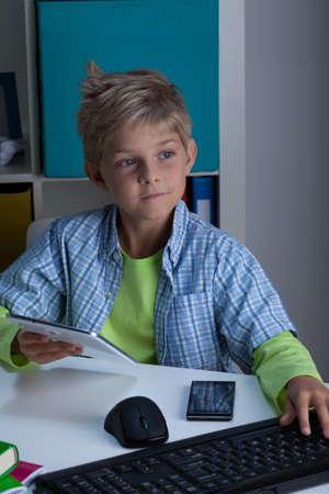 blond boy: Child living in virtual world using modern technologies