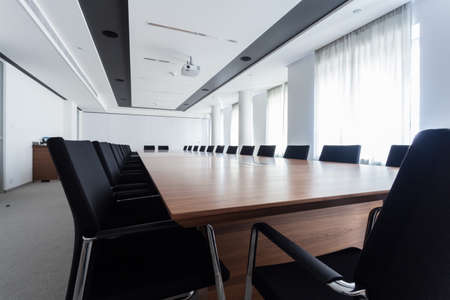 conference room meeting: Enormous table in a meeting room, horizontal
