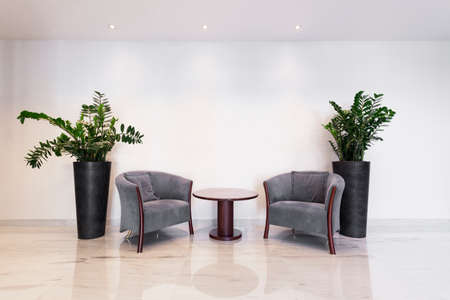Coffee table with armchairs in business office Foto de archivo