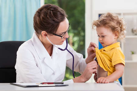 auscultation: Doctor during auscultation of a young patient