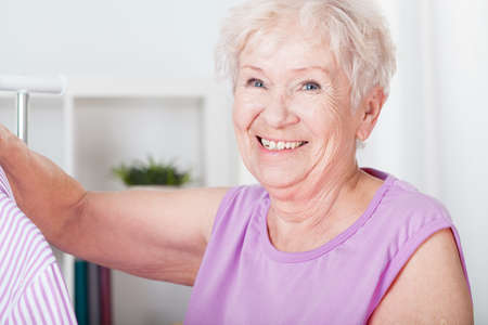 Portrait of smiling elderly woman with gray hair photo