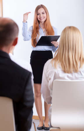 Young beutiful woman lecutring during her job interview photo