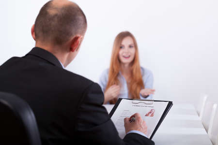 good looks: Young confident woman and her job interviewer