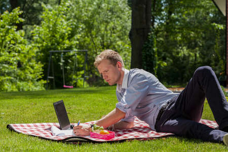 lieing: Man lieing on blanket and doing business case