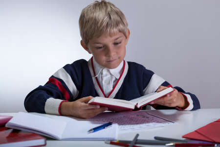 Image of top of the class writing book Stock Photo