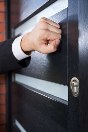 Door to door salesman knocking on the door