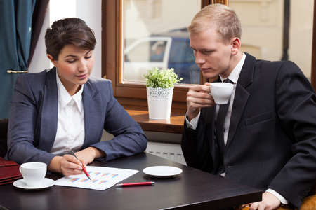 Horizontal view of business meeting in coffeehouse photo