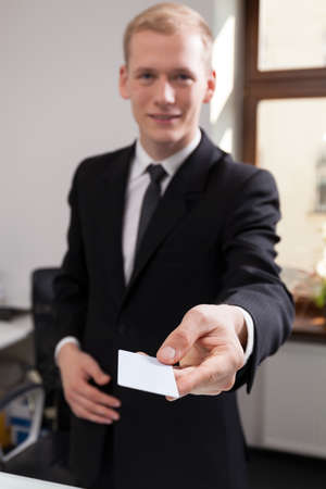 check in: Receptionist working at the hotel giving calling card Stock Photo