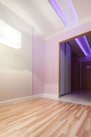 Pastel pink room with door to the hall photo