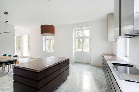 Space bright kitchen with marble floor photo