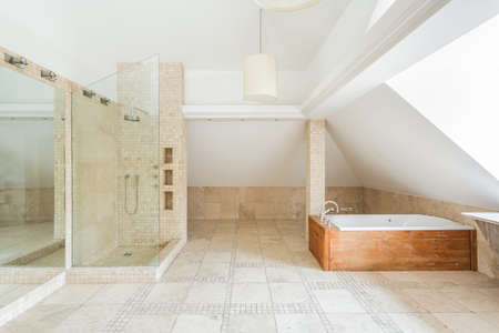 floor tiles: Deisgn of rock bathroom with wooden bathtub Stock Photo