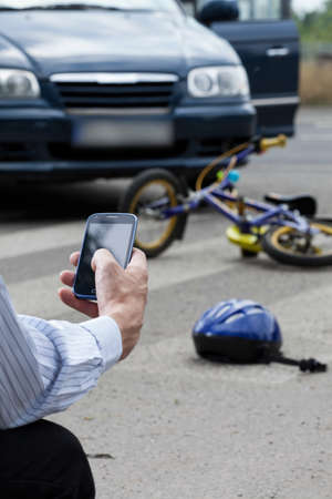 accident dead: A witness calling for help after crashing into a kid on a bike Stock Photo