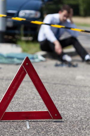 perpetrator: Closeup of area of a car accident and a man Stock Photo
