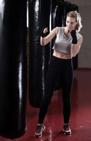 Boxing woman during her training at the gym