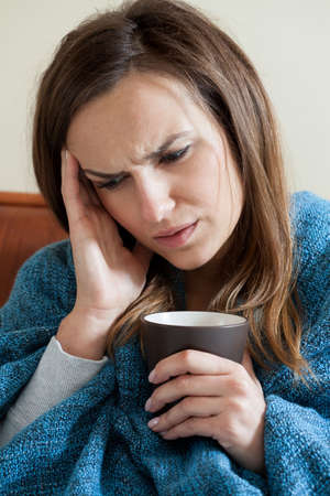 catarrh: Portrait of woman getting the flu and drinking tea Stock Photo