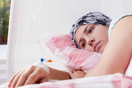 Photo of young pretty cancer girl lying in hospital Stock Photo