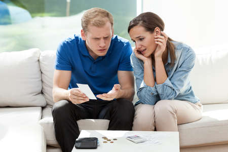 unpaid: Man reading high bill of his wife