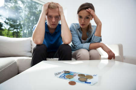 money issues: Frustrated couple not having money to live