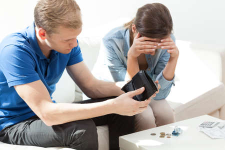 Poor couple with financial problems not having money photo