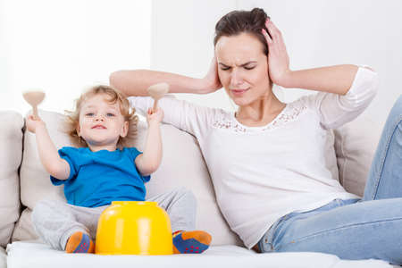 angry kid: View of mother and her loud child