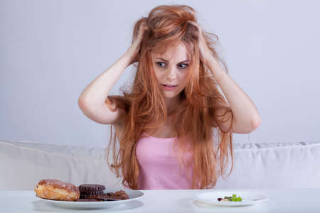 skinny girl: Young skinny girl having a diet frustration