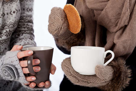 Drinking tea together on a cold day, horizontal photo