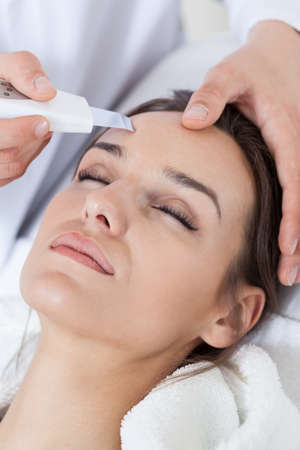 during: Relaxed woman during cavitation peeling in spa