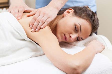 massage: Woman having arm massage in spa, horizontal Stock Photo
