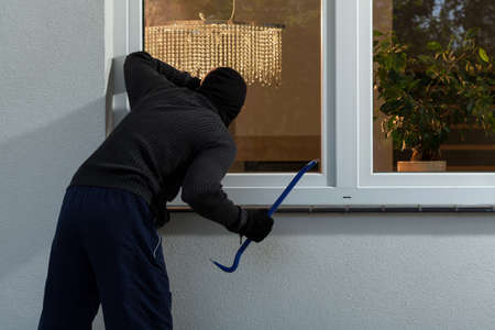 Burglar before burglary into the house, horizontal photo