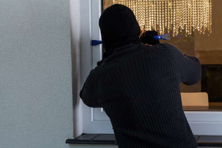 View of man breaking into the house photo