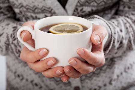 warm drink: Close-up of hands holding a cup of tea