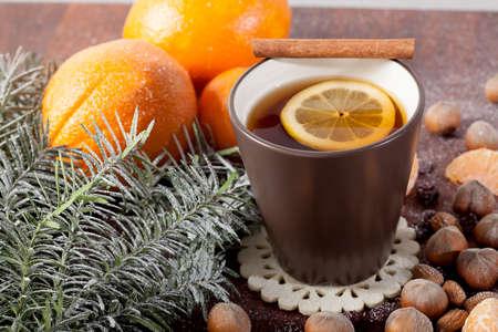 spiced: Christmas decoration and mug of hot tea, horizontal