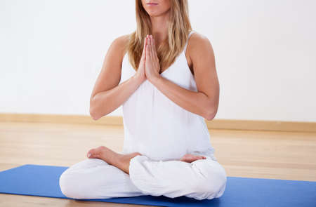 Close-up of woman training yoga at the gym photo