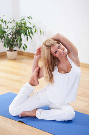 Image of woman in advanced yoga position photo